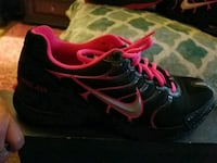 pair of black-and-pink Nike running shoes Kennesaw, 30152