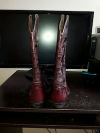 pair of red leather cowboy boots Toronto, M1L 1L3
