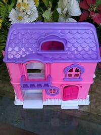 14 in high, pink with purple dollhouse, as is, must pick up