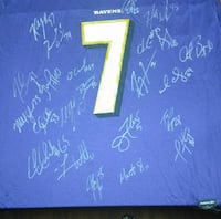 signed blue and white Baltimore Ravens jersey
