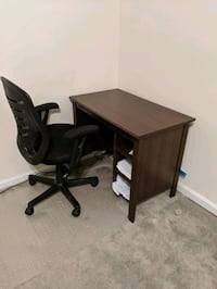 Brown desk and black desk chair