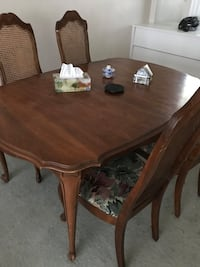 oval brown wooden dining table with chairs set