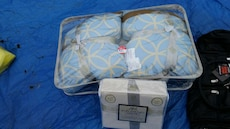 white-and-beige throw pillows in package