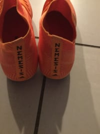 pair of orange Nike Mercurial Calgary, T2E 9C3