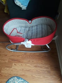 baby's red and gray bouncer 24 mi