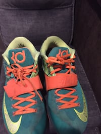 pair of blue-and-green Nike running shoes Accokeek, 20607