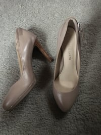 pair of beige leather pointed toe pumps