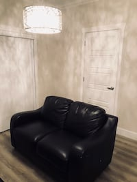 black leather sofa chair with ottoman Surrey, V4N
