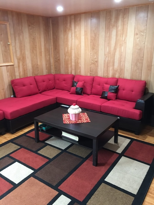 Brand new red linen sectional sofa with ottoman  386a83dc-8269-4b70-af41-308356e1596a