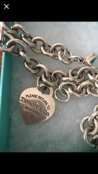 silver-colored Tiffany and Co. heart pendant with chain necklace