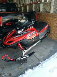 black and red yamaha snowmobile Hobart, 46342