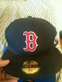 black and yellow fitted cap Boston, 02124