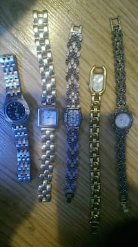 four round silver analog watches Barrie, L4N 4R2