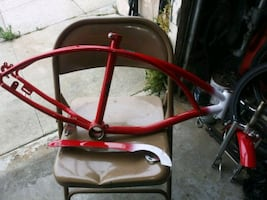 red and black bicycle frame