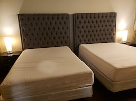 Full size with tall cloth headboards with night stands