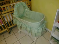 baby's white and green bassinet Palmetto Bay, 33157