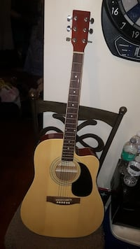 brown acoustic guitar