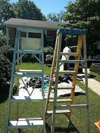 two gray steel A-frame ladders 26 km
