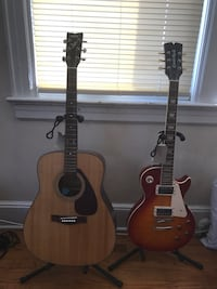 brown acoustic guitar and sunburst les paul guitar