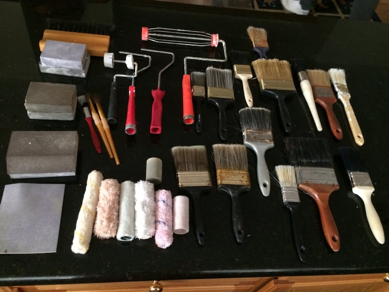 Assortment of painting brushes , rollers, sanding blocks etc... 31e13924-feaa-4c07-a637-ed2db95fafbc