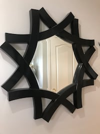 3ft wide x 3 ft tall mirror black framed with a unique design framed in hard black plastic plus two wall sconces all included for 60.00! Won't last!! Langley, V2Y 2V7