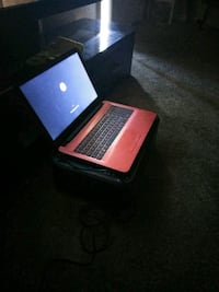 pink and black laptop computer