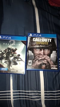 two Sony PS4 game cases