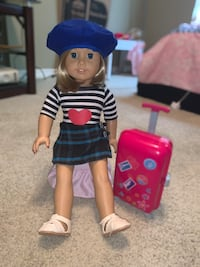 American girl doll with a suitcase
