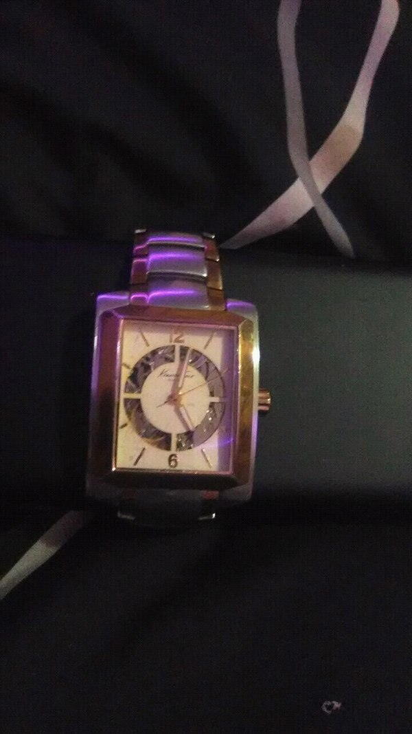 square silver analog watch with pink leather strap