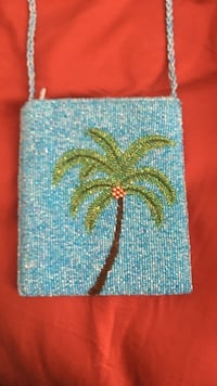 green coconut tree embroidered sling bag