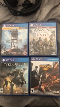 four assorted PS4 game cases Porterville, 93257
