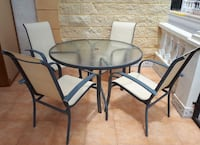 round black metal framed glass top patio table set Cleveland, 44122