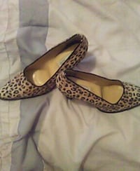 pair of black-and-beige leopard-print almond-toe k