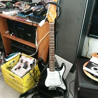 white and black electric guitar Vancouver, V6A 1S9