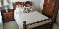 brown wooden bed frame with white mattress Herndon, 20170