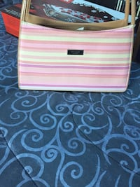 Pink and white leather crossbody bag by Kate spade