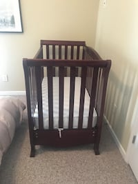 baby's brown wooden crib Roswell, 30075
