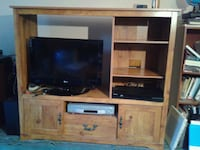 brown wooden TV hutch - TV not included