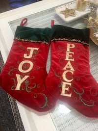 Pair of red-and-green joy and peace printed christmas stockings 5 for 2pivk up in briedlewood South West