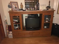 brown wooden TV hutch and flat screen television East Haven, 06512