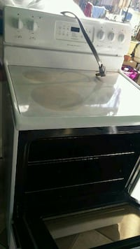 white and black Frigidaire smooth top range