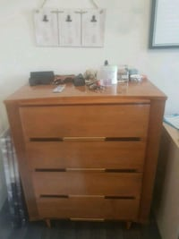 brown wooden 4-drawer chest Calgary