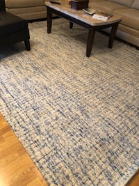 8x10 area rug - blue, cream and a little rust color.  Very nice! Kenner, 70065