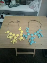 two blue and yellow bubble necklaces