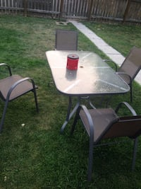 black metal framed glass top patio table with chairs Calgary, T2A 1H8