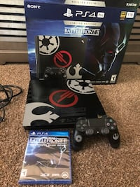 Black sony ps4 console with controller and game cases Chagrin Falls, 44022