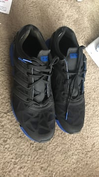 pair of black-and-blue Adidas low-top sneakers