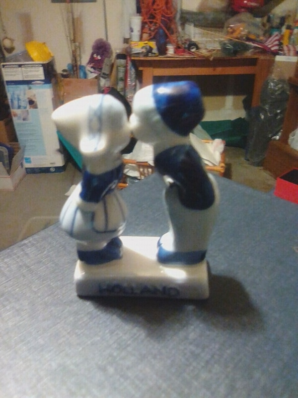 two white and blue ceramic figurines