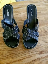 pair of black leather open-toe sandals Dearborn, 48126