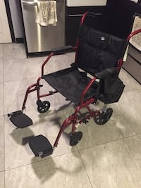 Transport Wheelchair with Footrests  758 mi